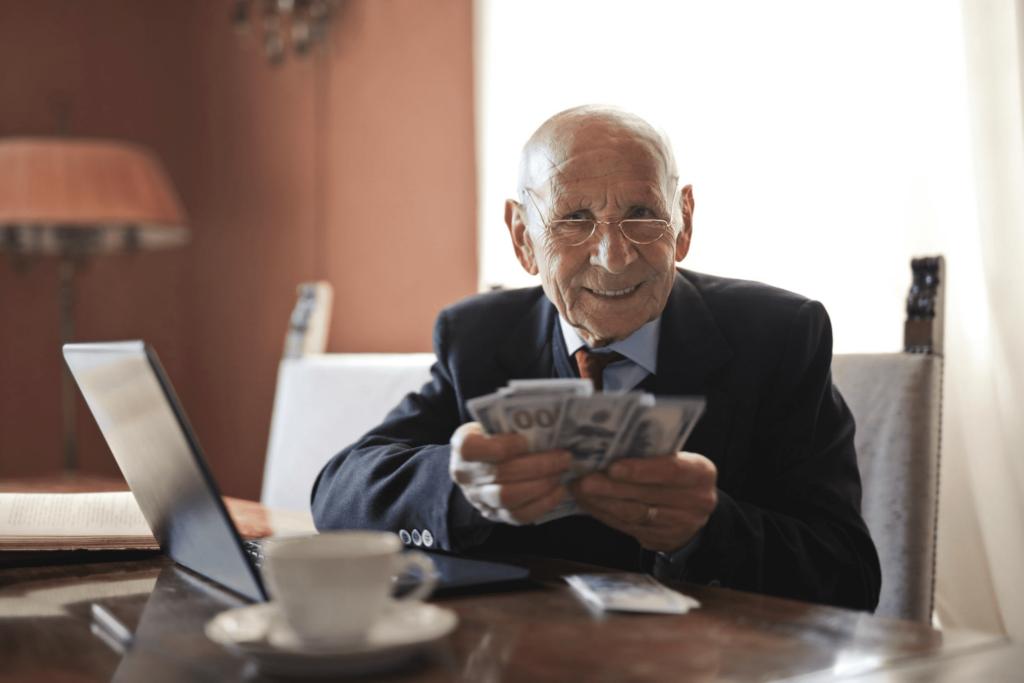 elderly man counts the money