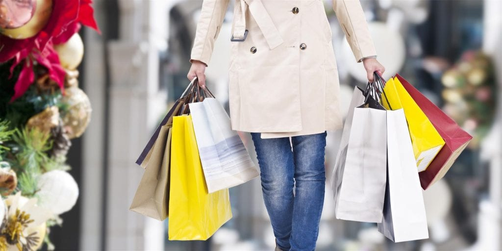 woman walking with shopping bags in hands