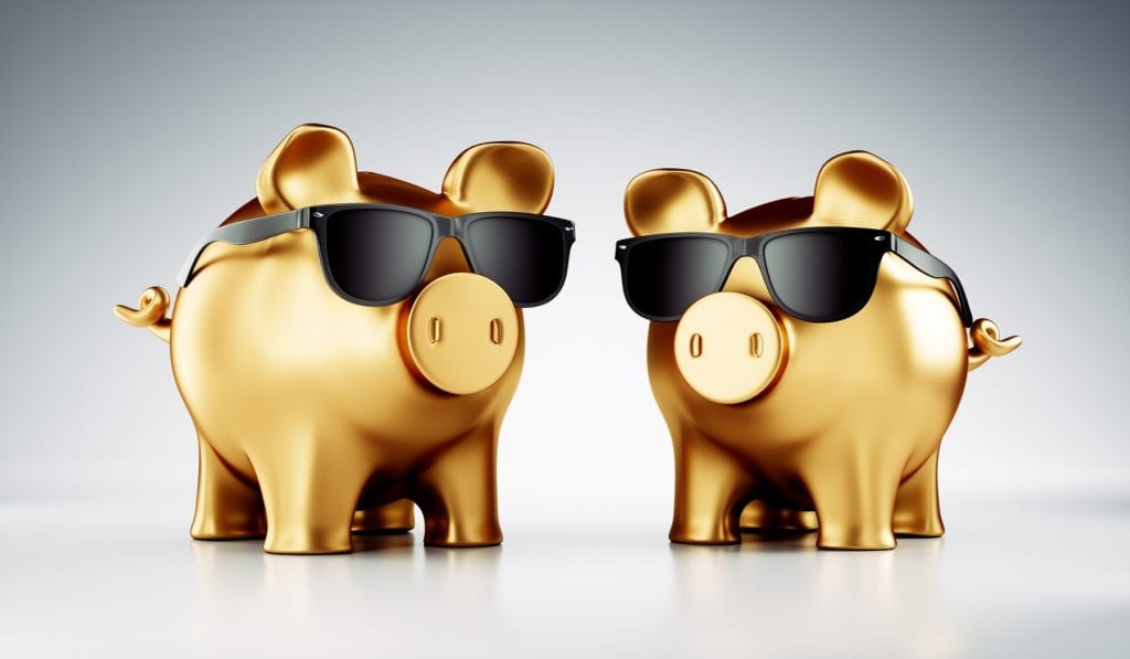 Two Cool Golden Piggy Banks With Sunglasses