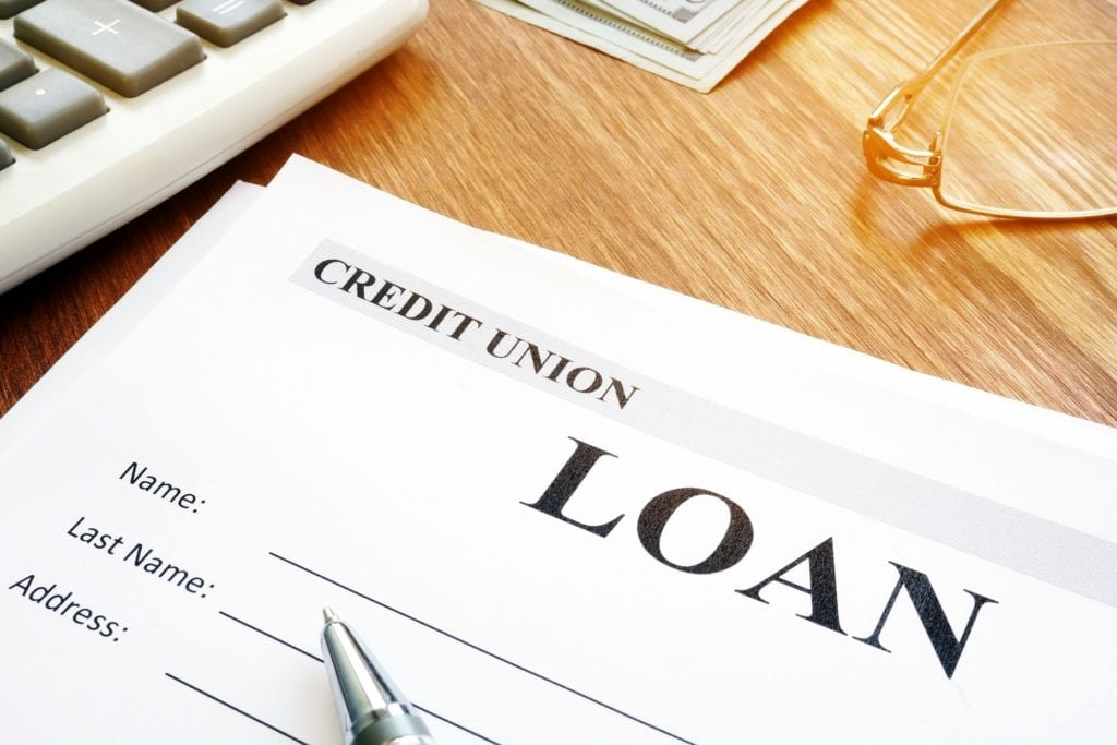 Credit union loan application form and pen