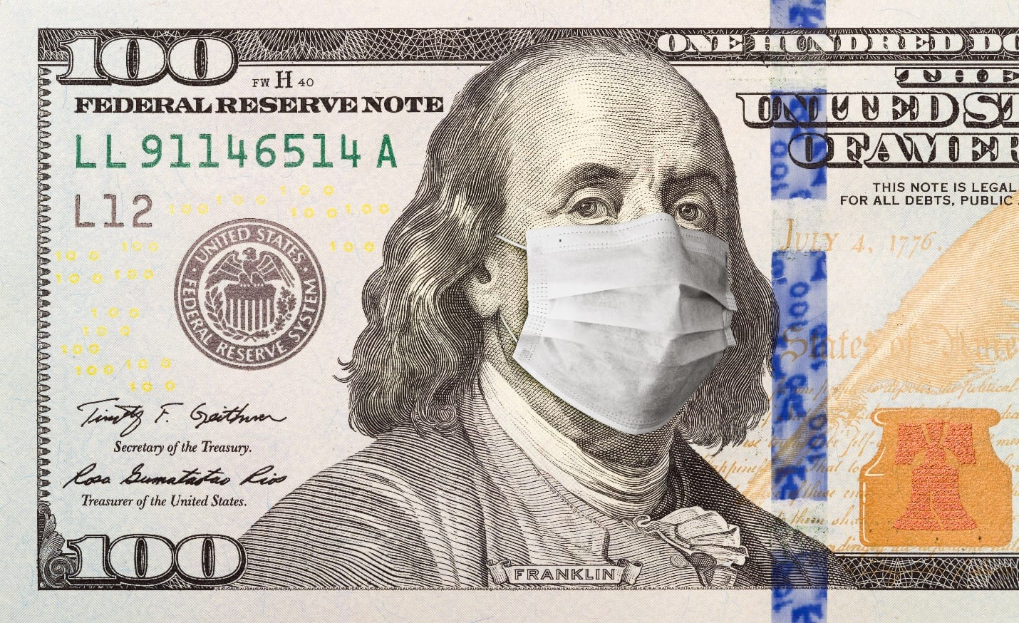 One Hundred Dollar Bill With Medical Face Mask on Benjamin Franklin
