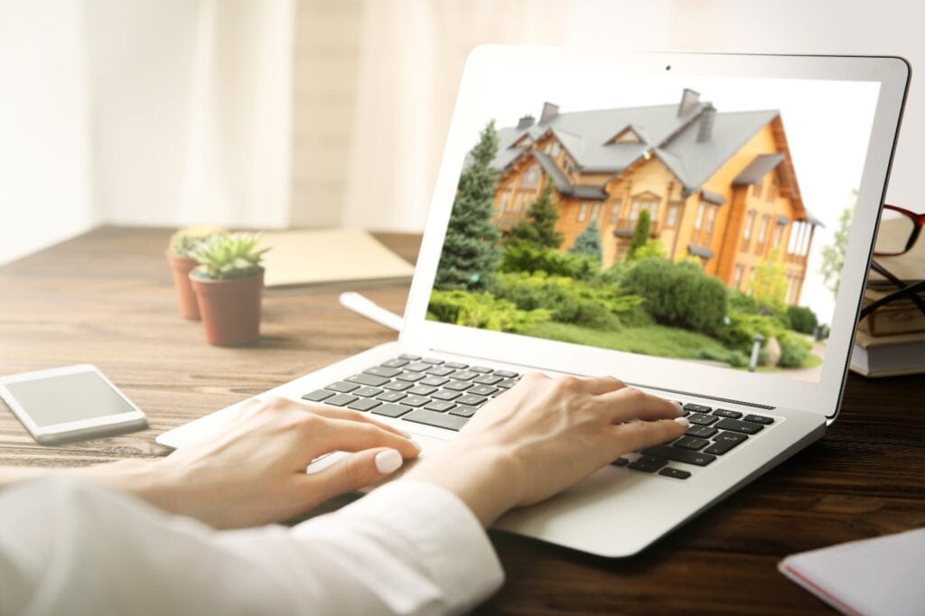 Woman looking for house on real estate market website