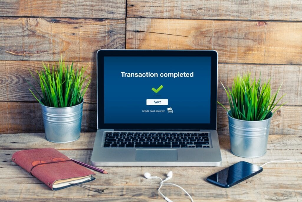 Transaction completed notification in a laptop screen