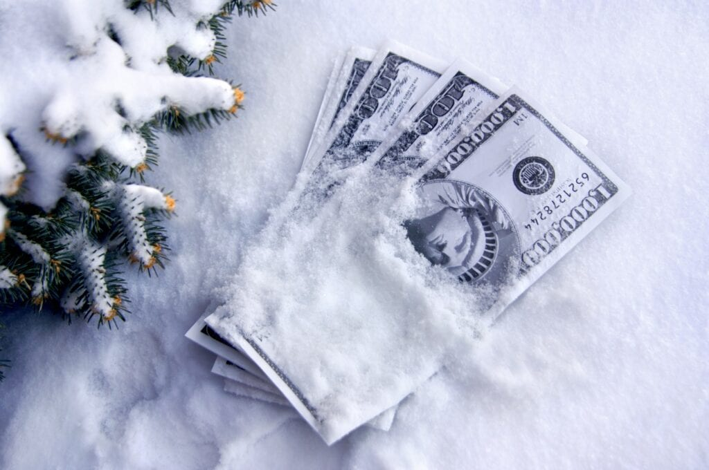 Cold cash lays in the snow