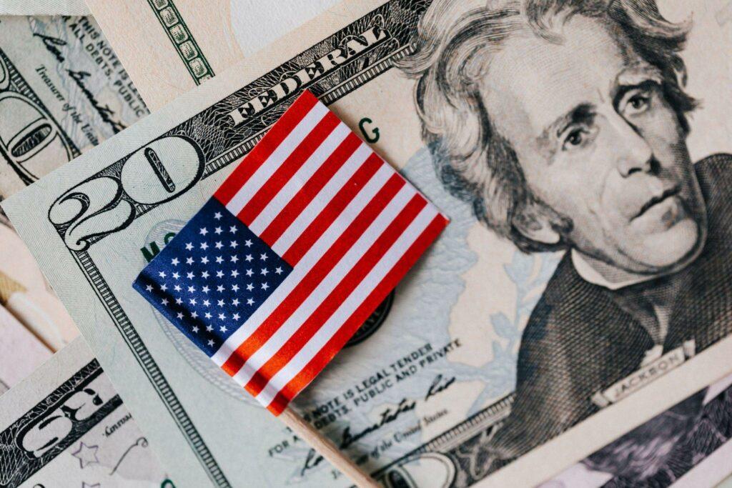 USA dollars and national flag