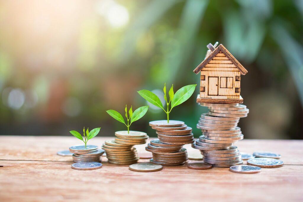 house model on money coins saving