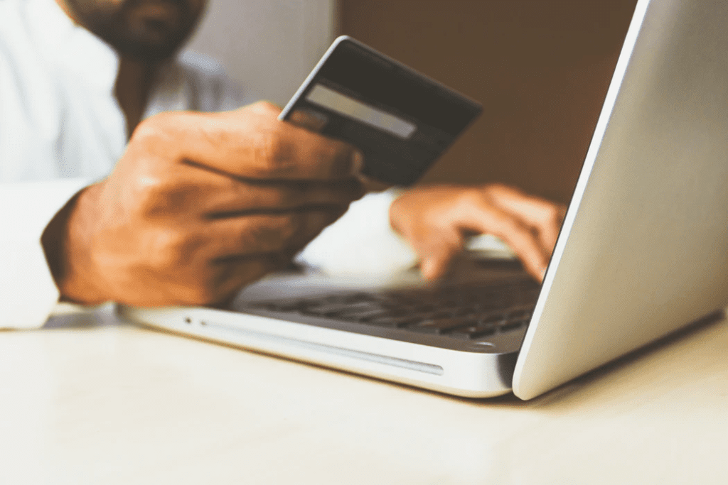 man shopping using laptop pc and credit card