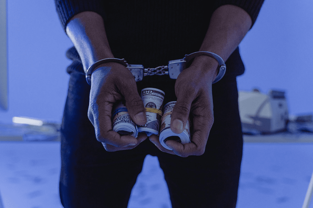 Handcuffs Hands Holding Money